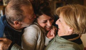 encinitas family hugging after discussing laser dentistry