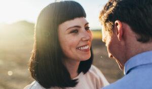 encinitas couple with lumineers smiling
