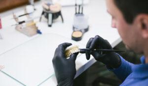 Encinitas prosthodontist holding a mold of teeth